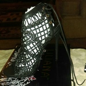 Shoes - Black cut out design Heel, new. In box